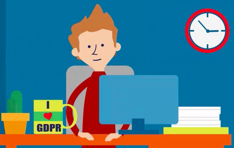 """Tecknad person vid skrivbord, med kaffekopp med texten """"I love GDPR""""."""